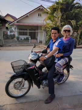 Me on scooter with Laotian friend
